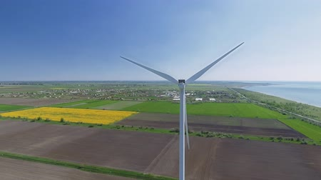 ecologically : Wind power turbines in the field. Aerial view Stock Footage