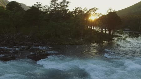 norveç : Aerial view of river in Husedalen Valley, Norway. Summer time. Sunset Stok Video