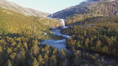 rohanó : Aerial view of Rapid Stunning Waterfall in Husedalen Valley, Norway. Summer time. Stock mozgókép