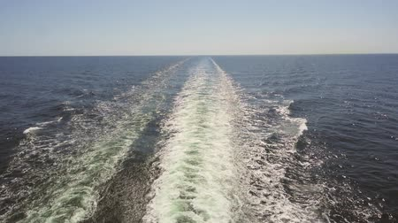 kruvazör : Footage of turquoise foamy sea waves behind rapid motor boat.