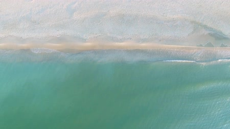 pacific islands : Narrow beach line, waves and ocean. Aerial view. Stock Footage