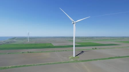 malom : Wind power turbines in the field. Aerial view Stock mozgókép