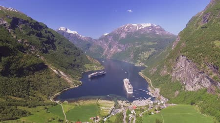 norueguês : Geiranger fjord area, Norway. Aerial view at summer time. Fairytale landscape with its majestic, snow-covered mountain tops. Fantastic view of one of most beautiful tourist destinations in the world