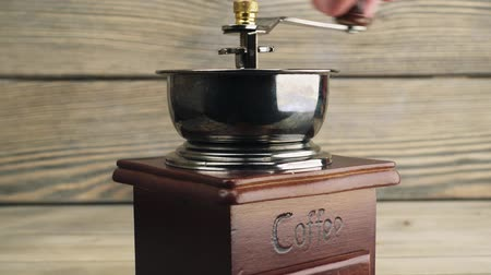 drawer : grinds coffee on brass hand mill