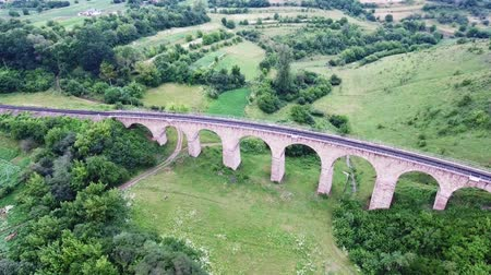 natural arch : The old railroad bridge, built in the time of Austro-Hungarian Empire in Western Ukraine in Ternopil region. Aerial view.
