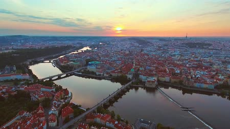 cseh : View from above on the cityscape of Prague, flight over the city, top view, Vltava River, Charles Bridge