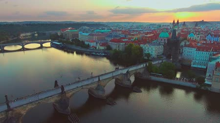 townhouse : 4K 3840x2160 Czech Republic Prague Aerial Flying low around Charles Bridge with cityscape views Stock Footage
