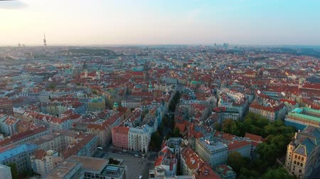 Богемия : Aerial Birdseye flying low around Old Town Square, sunrise, Prague, Czech Republic Стоковые видеозаписи
