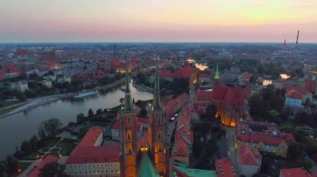 wrocław : Aerial: Cathedral Island in Wroclaw, Poland. Wroclaw View at Tumski island and Cathedral of St John the Baptist. Video with Oder River in Foreground. Beautiful City in Poland.