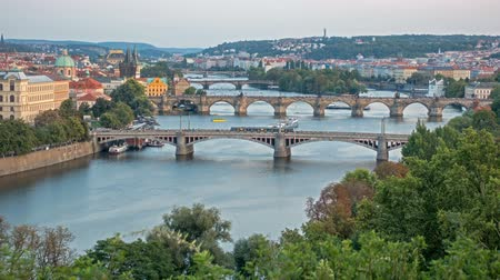 Богемия : Bridges of Prague including the famous Charles Bridge over the River Vitava Czech Republic at sunset, time lapse. day to night. Europe