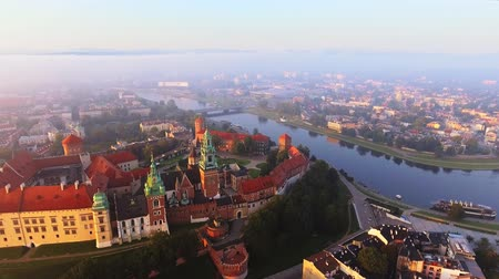 wawel : Krakow, Poland. Wawel royal Castle and Cathedral, Vistula River. Aerial 4K flyby video at sunrise in summer