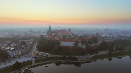 wawel : Krakow, Poland. Wawel royal Castle and Cathedral, Vistula River. Cracow old city with historic churches in the background. Aerial 4K flyby video at sunrise in summer Stock Footage