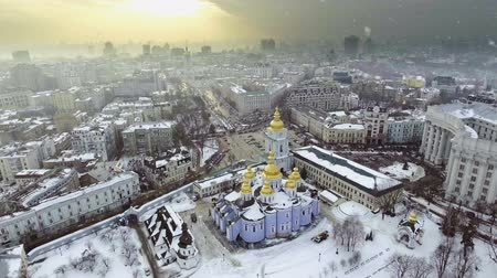 st michael the archangel : Aerial view to Saint Michael Golden Domed Cathedral in the center of Kyiv. It is a functioning monastery in Kiev, the capital of Ukraine. Falling snow