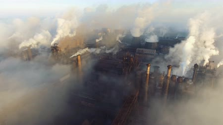 nuclear power : Aerial view. Pipes Throwing Smoke in the Sky. Large Plant on the City.