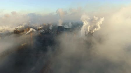 emissions : Pollution of the environment: a pipe with smoke. Industrial zone. Aerial view
