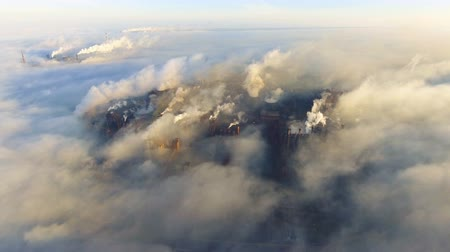 emissions : Aerial view. Pipes Throwing Smoke in the Sky. Large Plant on the City.