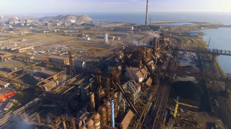 metallurgical : Aerial view over dirty smoke and smog from pipes of steel factory and blast furnaces. industrialized city, pollution from metallurgical plant. Ecological Stock Footage
