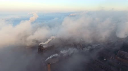 metallurgical : Top view of the metallurgical plant. Smoke coming out of factory pipes. ecology