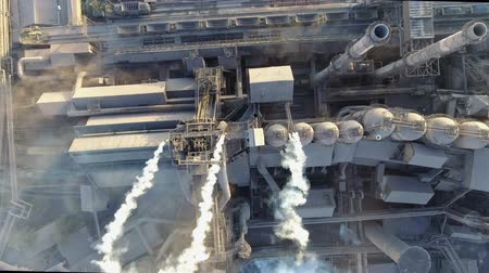 над : Top view of the metallurgical plant. Smoke coming out of factory pipes. ecology
