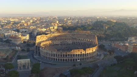 colosseo : Flying over Colosseum, Rome, Italy. Aerial view of the Roman Coliseum on sunrise