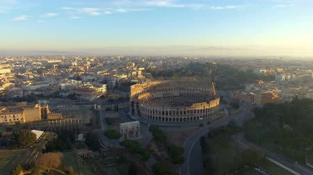 flying towards Colosseum also known as Coliseum or Flavian Amphitheater