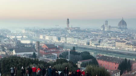 Italy, Florence - JANUARY 9, 2019: tourists meet the sunset at Piazzale Michelangelo. Florence. Italy. timelapse