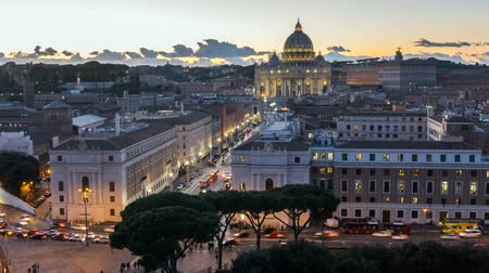 st.peter basilica vatican illuminated by night lights at dusk hour in Italy Стоковые видеозаписи