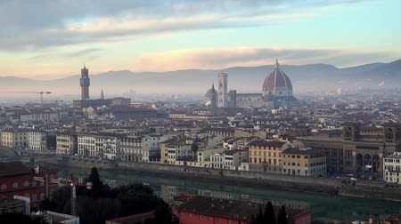 bell tower : FLORENCE in Italy with the dome and Palazzo della Signoria and arno river