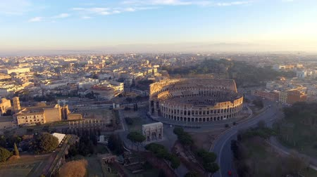 roma : Flying over Colosseum, Rome, Italy. Aerial view of the Roman Coliseum on sunrise