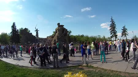 rabble : mass of people visited the memorial complex Mamaev Kurgan in celebration of the anniversary of victory over fascism Stock Footage
