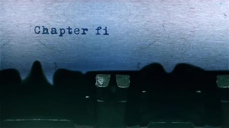 conta : chapter five The Word closeup Being Typing With Sound and Centered on a Sheet of paper on old Typewriter 4k Footage .