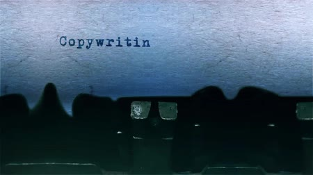 conta : Copywriting The Word closeup Being Typing With Sound and Centered on a Sheet of paper on old Typewriter 4k Footage .