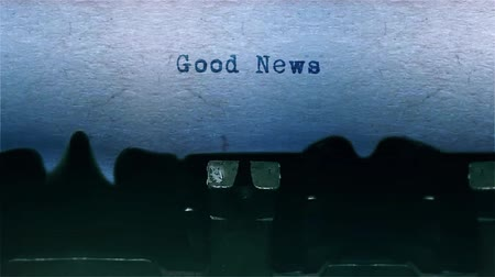 conta : good news The Word closeup Being Typing With Sound and Centered on a Sheet of paper on old Typewriter 4k Footage . Vídeos