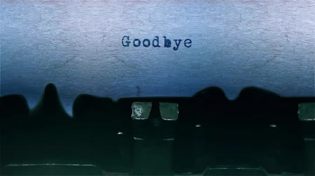 bölüm : goodbye The Word closeup Being Typing With Sound and Centered on a Sheet of paper on old Typewriter 4k Footage .
