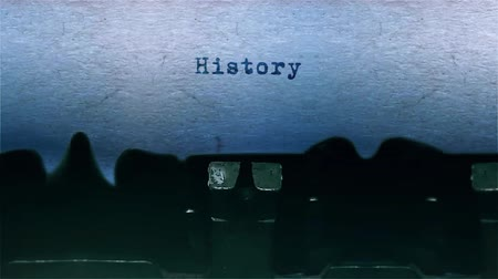 conta : History The Word closeup Being Typing With Sound and Centered on a Sheet of paper on old Typewriter 4k Footage . Vídeos
