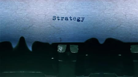 stories : strategy The Word closeup Being Typing With Sound and Centered on a Sheet of paper on old Typewriter 4k Footage . Stock Footage