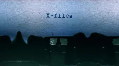 conta : X-files The Word closeup Being Typing With Sound and Centered on a Sheet of paper on old Typewriter 4k Footage . Vídeos
