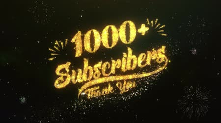 részvény : 1000+ Subscribers Text Greeting Wishes Sparklers Particles Night Sky Firework Stock mozgókép