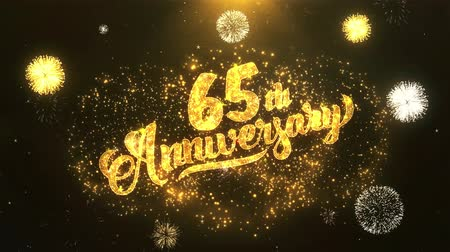 fireworks : 65th happy anniversary Greeting Card text Reveal from Golden Firework & Crackers on Glitter Shiny Magic Particles Sparks Night for Celebration, Wishes, Events, Message, holiday, festival