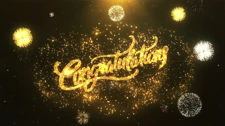 kraker : Congratulations Greeting Card text Reveal from Golden Firework & Crackers on Glitter Shiny Magic Particles Sparks Night for Celebration, Wishes, Events, Message, holiday, festival Stok Video