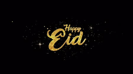 islámský : Eid Mubarak Beautiful golden greeting Text Appearance from blinking particles with golden fireworks background.