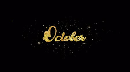 aylık : October Beautiful golden greeting Text Appearance from blinking particles with golden fireworks background. Stok Video