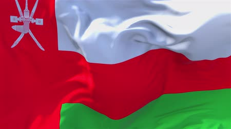 oy : Oman Flag Waving in Wind Slow Motion Animation . 4K Realistic Fabric Texture Flag Smooth Blowing on a windy day Continuous Seamless Loop Background.