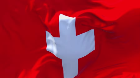 valais : Switzerland Flag Waving in Wind Slow Motion Animation . 4K Realistic Fabric Texture Flag Smooth Blowing on a windy day Continuous Seamless Loop Background.
