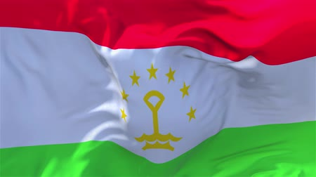 náboženství : Tajikistan Flag Waving in Wind Slow Motion Animation . 4K Realistic Fabric Texture Flag Smooth Blowing on a windy day Continuous Seamless Loop Background.