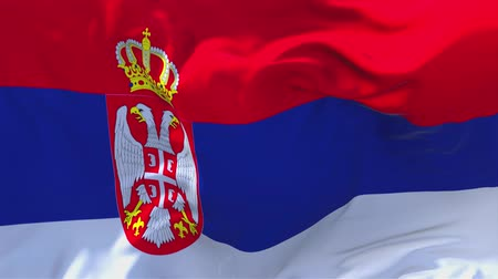sérvia : Serbia Flag Waving in Wind Slow Motion Animation . 4K Realistic Fabric Texture Flag Smooth Blowing on a windy day Continuous Seamless Loop Background.
