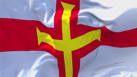 nationality : Guernsey Flag Waving in Wind Slow Motion Animation . 4K Realistic Fabric Texture Flag Smooth Blowing on a windy day Continuous Seamless Loop Background.