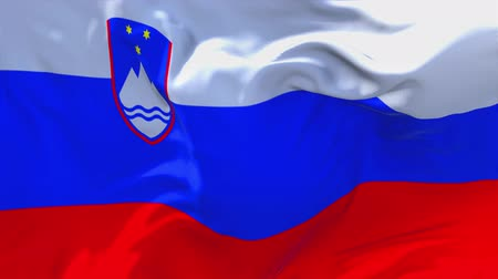 slovinsko : Slovenia Flag Waving in Wind Slow Motion Animation . 4K Realistic Fabric Texture Flag Smooth Blowing on a windy day Continuous Seamless Loop Background.