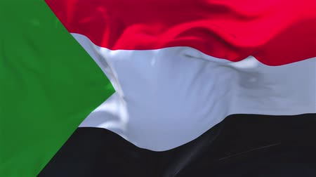 siyasi : Sudan Flag Waving in Wind Slow Motion Animation . 4K Realistic Fabric Texture Flag Smooth Blowing on a windy day Continuous Seamless Loop Background.