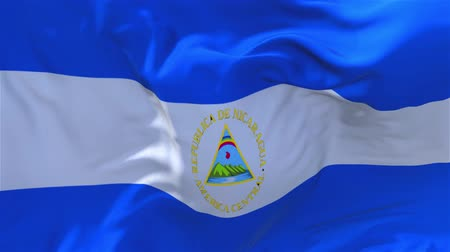 národnost : Nicaragua Flag Waving in Wind Slow Motion Animation . 4K Realistic Fabric Texture Flag Smooth Blowing on a windy day Continuous Seamless Loop Background. Dostupné videozáznamy